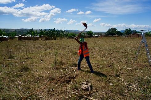 Irene, field technician installing a pole